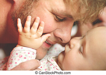 Happy Father Loving Newborn Baby Girl - A happy father is...
