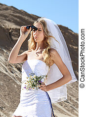 Looking for the groom - Beautiful bride in her white dress...