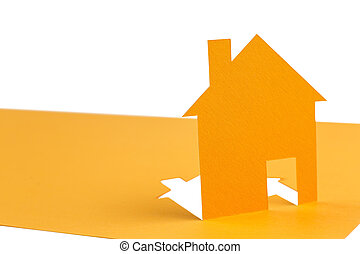Orange house cut out of paper