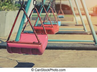 Empty children swing set in playground - Empty children...