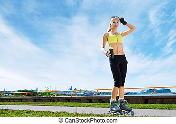 Young and fit woman rollerblading on skates - Fit, sporty...