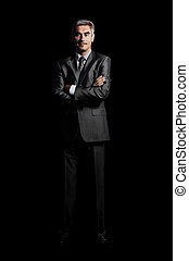 Closeup of a smiling man isolated over black background -...