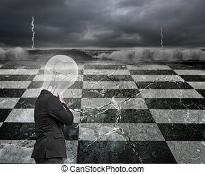 Thinking man with lamp head and chin in hand on chessboard...