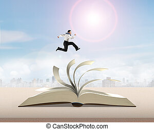 Man running and jumping on open book - Man running and...