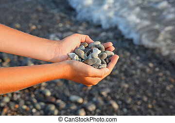 Handful of stones in hands