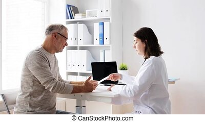 senior man and doctor meeting at hospital 57 - medicine,...