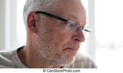 sad senior man talking to someone indoors 38