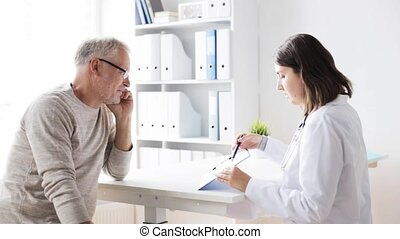 senior man and doctor meeting at hospital 44 - medicine,...
