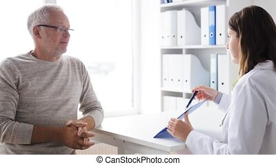 senior man and doctor meeting at hospital 47 - medicine,...
