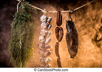 Ham, sausage and garlic in a homemade smokehouse
