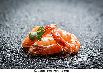 Closeup of fresh shrimp on a rock