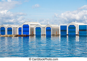 Boat Houses with Blue Doors on Blue Water