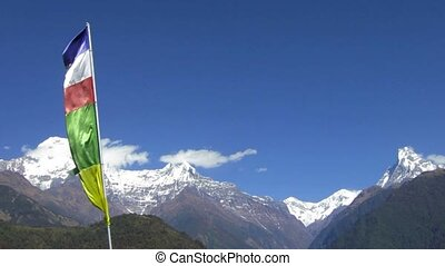 The Annapurna range in Nepal Prayer flags in the foreground...