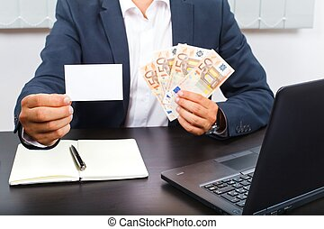 Success in business - Successful young businessman sitting...