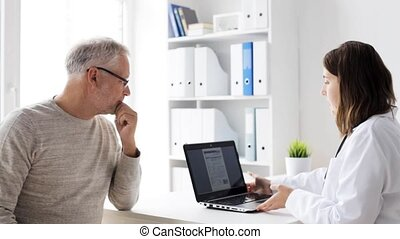 senior man and doctor with tablet pc at hospital - medicine,...