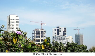 Construction of new houses nearby park. - Construction of...
