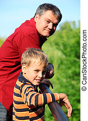 man and boy outdoor in summer