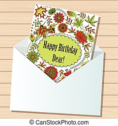 happy birthday dear card in envelope on wooden background -...