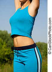 young woman during fitness in the country