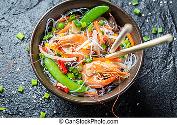 Traditional dish with shrimp and noodles