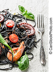 Spaghetti with seafood and black pasta
