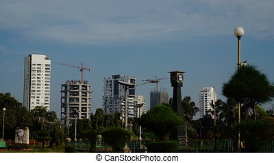 Construction of buildings overlooking on garden. -...