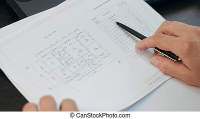 Checking of papers with construction documentation - Male...