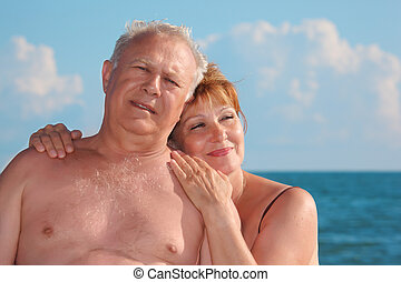 portrait of aged pair against sea, focus on woman