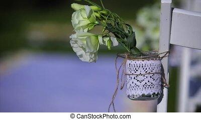 flowers hanging in mason jar at wedding.
