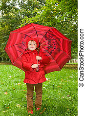 little girl with umbrella in park