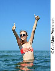 Girl standing in the water - Caucasian girl standing in the...