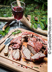 Sharing freshly roasted venison on a chopping board