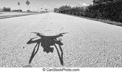 Shadow of a drone about to take off.