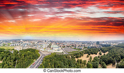 Sunset aerial view of Berlin landmarks. Brandenburg Gate and...