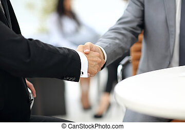 Business people shaking hands over a deal - Business people...