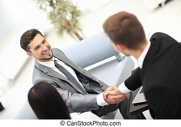 Two cheerful business men shaking hands - Two happy young...