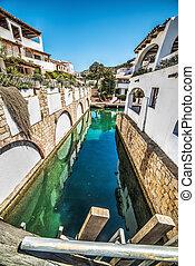 narrow canal in Poltu Quatu, Sardinia