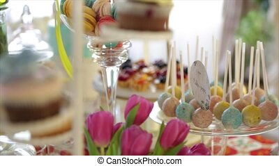 delicious decorated candy bar, sweets on tables for wedding reception