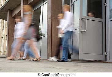 People leaving doors