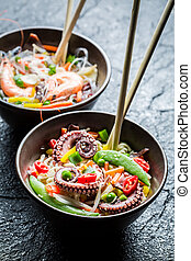 Traditional dish with seafood and noodles