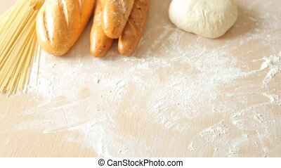 Baker is putting freshly baked loaf of homemade organic...