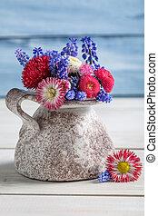 Blue spring flowers in a vase