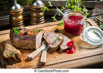 Healthy venison with cranberries and rosemary