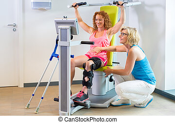 Patient getting help with leg rehabilitation - Patient in...