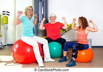 Patients and trainer flexing bicep muscles
