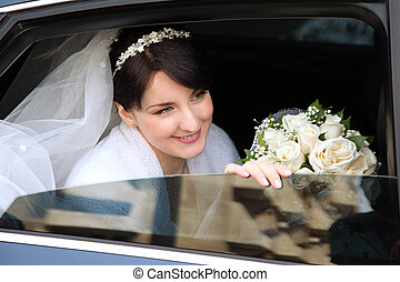 smiling bride in the car