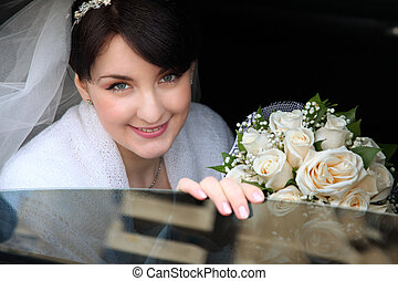 happy bride in the car