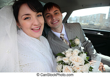 bride with fiance in car