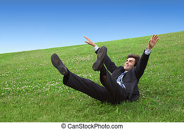 Businessman lying on the meadow