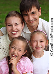 family of four outdoor in summer
